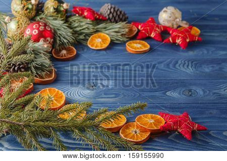 Spruce Twig With Dried Orange Slices On Oak Table, Christmas Background