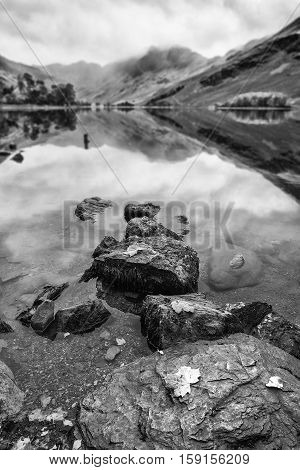 Beautiful Autumn Fall Black Adn White Landscape Image Of Lake Buttermere In Lake District England