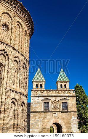 Santiago del Arrabal Church and Puerta de Bisagra Nueva Gate in Toledo - Spain