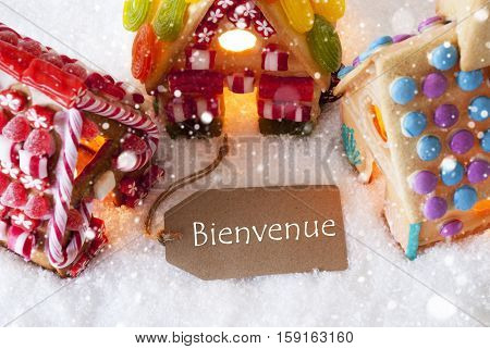 Label With French Text Bienvenue Means Welcome. Colorful Gingerbread House On Snow And Snowflakes. Christmas Card For Seasons Greetings