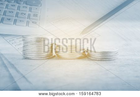 Double exposure stack of coins with utility bill with calculator and pencil and account banking for finance, Money and finance concept