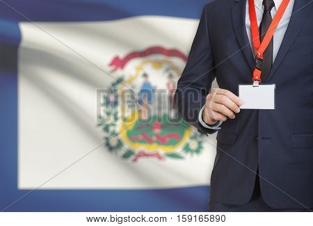 Businessman Holding Badge On A Lanyard With Usa State Flag On Background - West Virginia
