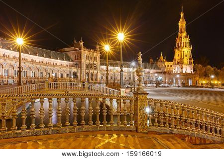 Patterned fence of the bridge on the Spain Square or Plaza de Espana in Seville at night, Andalusia, Spain