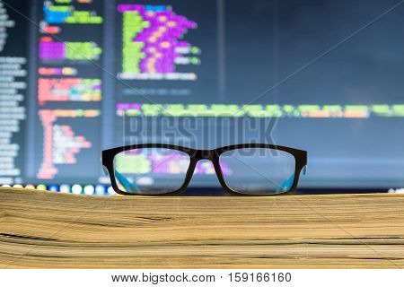 Eyeglasses in front off computer screen with Code syntax
