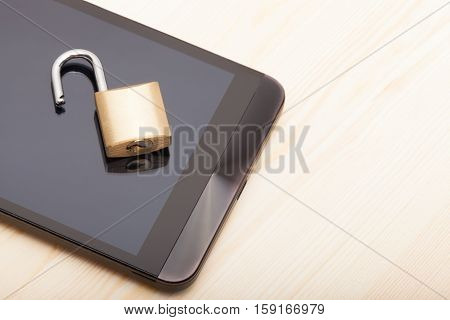 Smartphone With An Unlocked Lock Over It. Mobile Phone Security And Data Protection Concept