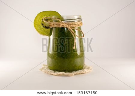 green smoothies of kiwi and spinach on a white background