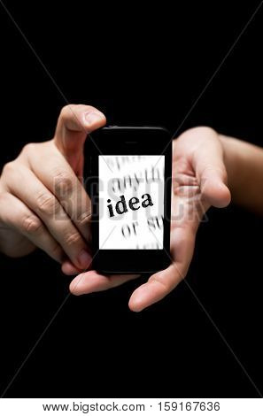 Hands Holding Smartphone, Showing  The Word Idea  Printed