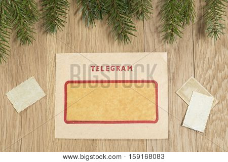 Christmas background with the vintage telegram on oak background