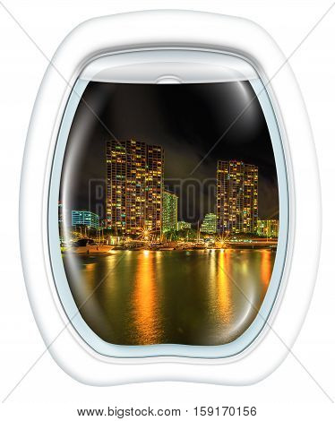 Plane window on Ala Wai Harbor, Honolulu skyline by night, Oahu, Hawaii, from a plane through the porthole. Copy space.