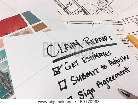 Help with home insurance claim repairs and getting paid full compensation step by step checklist. Get Estimates, work with adjuster to get approval, agree to repairs with check boxes list on desk with estimates, pen and blueprints for reconstruction