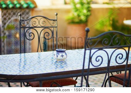 Table With Blue Ceramic Ash Tray Ain Cozy Moroccan Cafe