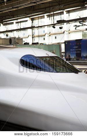HIROSHIMA, JAPAN - OCTOBER 10, 2016: Shinkansen N700 speed train at Hiroshima station in Japan. N700 series trains have a maximum speed of 300 km/h.