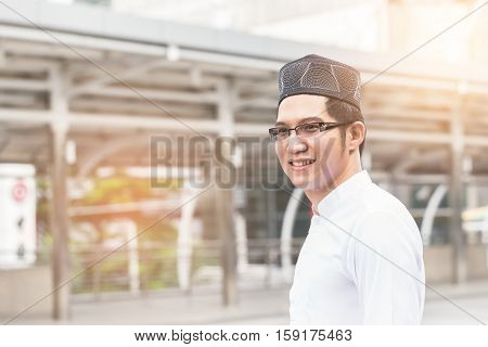 Young Handsome Businessman Arab Muslims Standing At Central Of City. Business In City Concept.