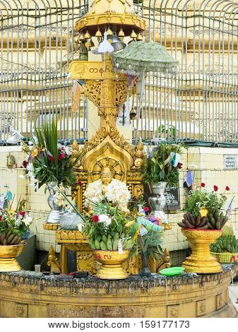Buddha image decorated with flowers at the Botahtaung Pagoda in Yangon Myanmar