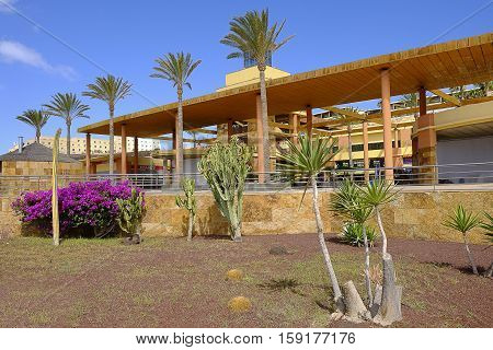 Shopping-center with a garden outside in Morro Jable. Canary island Fueteventura Spain - 25.06.2016.