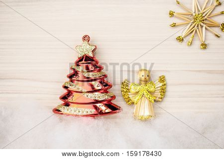 Christmas. Tree angel star on wooden background wooden angel. star in hands of angel. European holiday traditions. Tree - holiday concept. 2017 happy new year