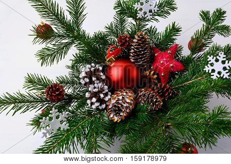 Christmas table centerpiece with golden decorated pine cones and snowflakes. Christmas rustic decoration.