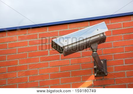 close-up view on security camera and urban video