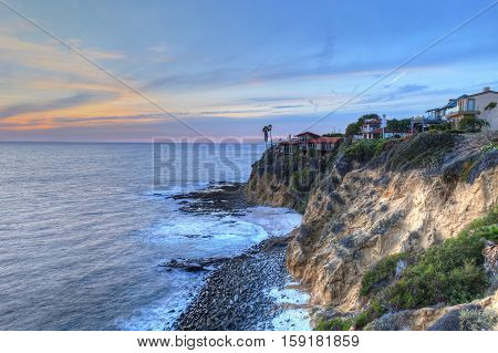 Sunset view of the ocean from the cliffs of Crescent Bay Point Park in Laguna Beach, California