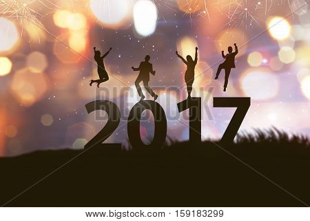 People silhouette celebrate 2017 new year. With fireworks background
