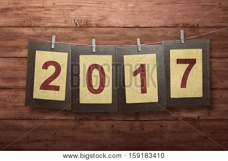 New Year 2017 In Photo Frame Hanging On Clothesline