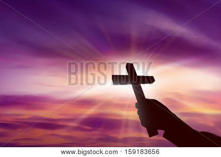 Silhouette Of Hand Holding Christian Cross
