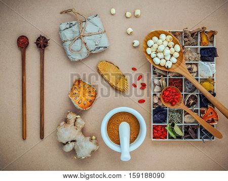 Alternative Health Care And Herbal Medicine. Dried Various Chinese Herbs In Wooden Box And Lotus See