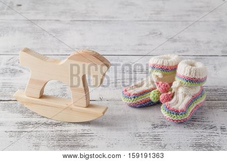 Newborn Announcement Template. Handmade Knitted Booties With Toy