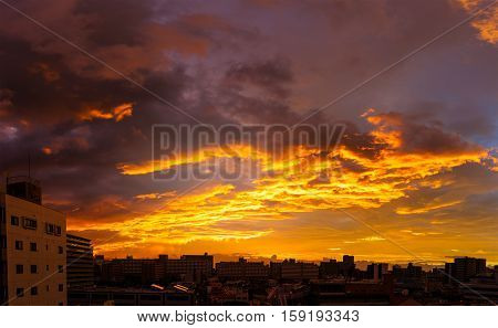 Orange sky with cloud and build in the morning