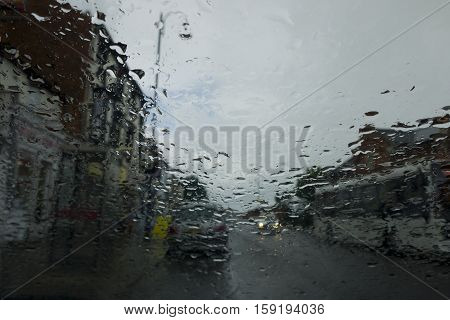 Raindrops on a windscreen in Wolverton Road Stoney Stratford in Buckinghamshire England.