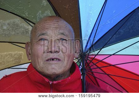 KUNDE, NEPAL - Oct, 2007: Portrait of a Sherpa Tibetan Buddhist monk in Kunde in the Khumbu Himalaya in the Everest region of Nepal.