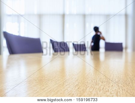 Blurred People talking on phone Boardroom meeting Business background
