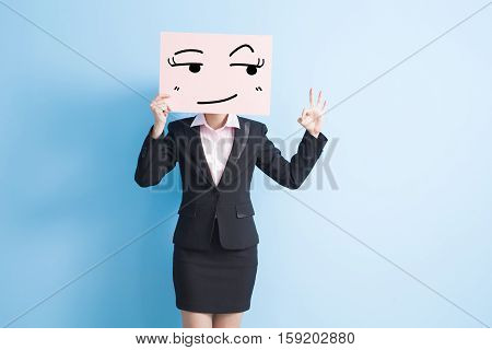 business woman take look somewhere billboard and show ok to you isolated blue background