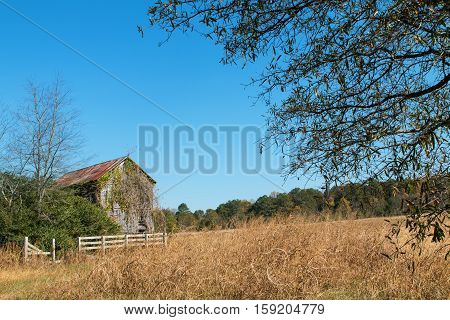An abandoned rundown farmhouse sits in a North Georgia field.