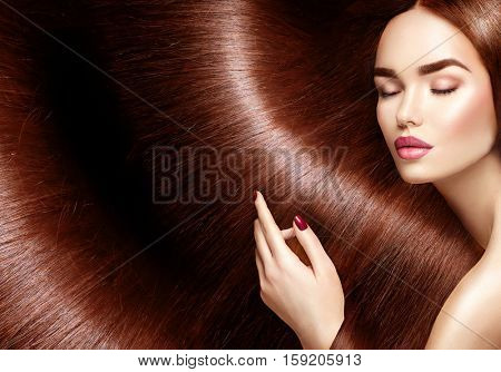 Beautiful Long Hair. Beauty woman with luxurious long straight brown hair as background. Model girl touching Healthy Hair. Lady with long smooth shiny straight hair. Hairstyle. Cosmetics, haircare