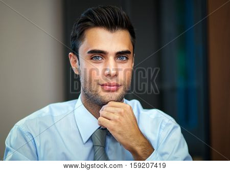 Young businessman sitting at his desk