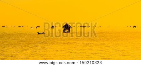 Fishermen's cottages middle of the sea in Thailand
