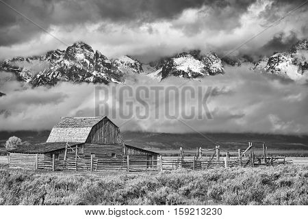 Black And White Teton Mountain Range With Moulton Barn In Grand Teton National Park, Wyoming, Usa.