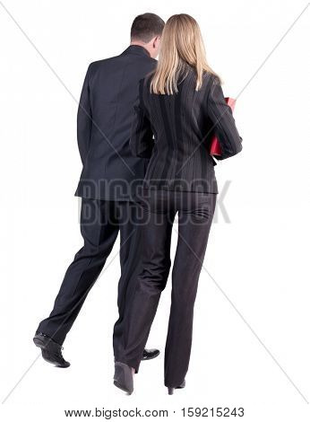 Back view of walking business team. Going young couple (man and woman) with books. beautiful friendly girl and guy in suit go get an education.  backside view of person. Isolated over white background