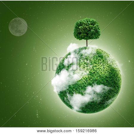 Green planet. Ecology concept. Green planet earth with a tree on  background of space . Go green.