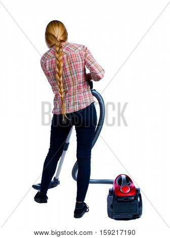 Rear view of a woman with a vacuum cleaner. She is busy cleaning. Rear view people collection.  backside view of person.  Isolated over white background. Girl in plaid shirt vacuuming the floor.