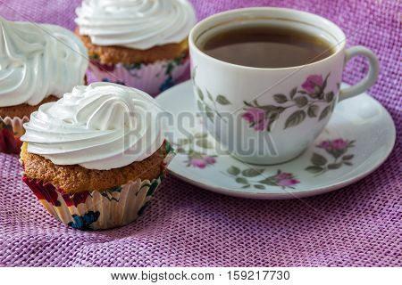 Muffin, decorated with whipped protein cream  and cup of  tea