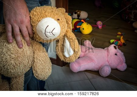 Picture of pedophile standing in the child room and offering cuddly toy to child poster