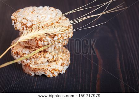 Dietary a low caloric grain crackers on a dark wooden background
