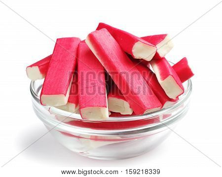 Crab sticks in a glass bowl on a white background
