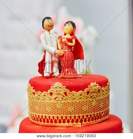 Beautiful Red And Yellow Wedding Cake In Indian Style