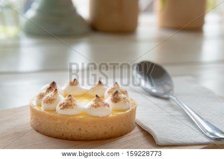 Lemon Tarts On Wood Plate