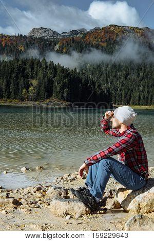 Hipster Traveler Enjoying View Of Black Lake, Durmitor National Park, Zabljak, Montenegro