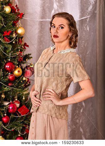 Woman dressing Christmas tree. Black and white.