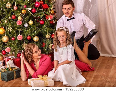 Christmas morning for the family. Happy family Christmas presents pleases. Christmas tree on background. Retro style.